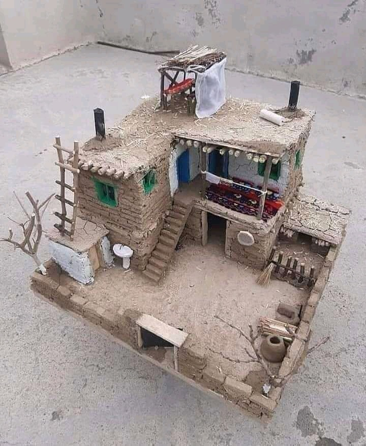 A small doll house mad out of mud - meme