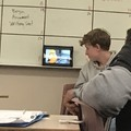 This kid actually watching killer bean in class