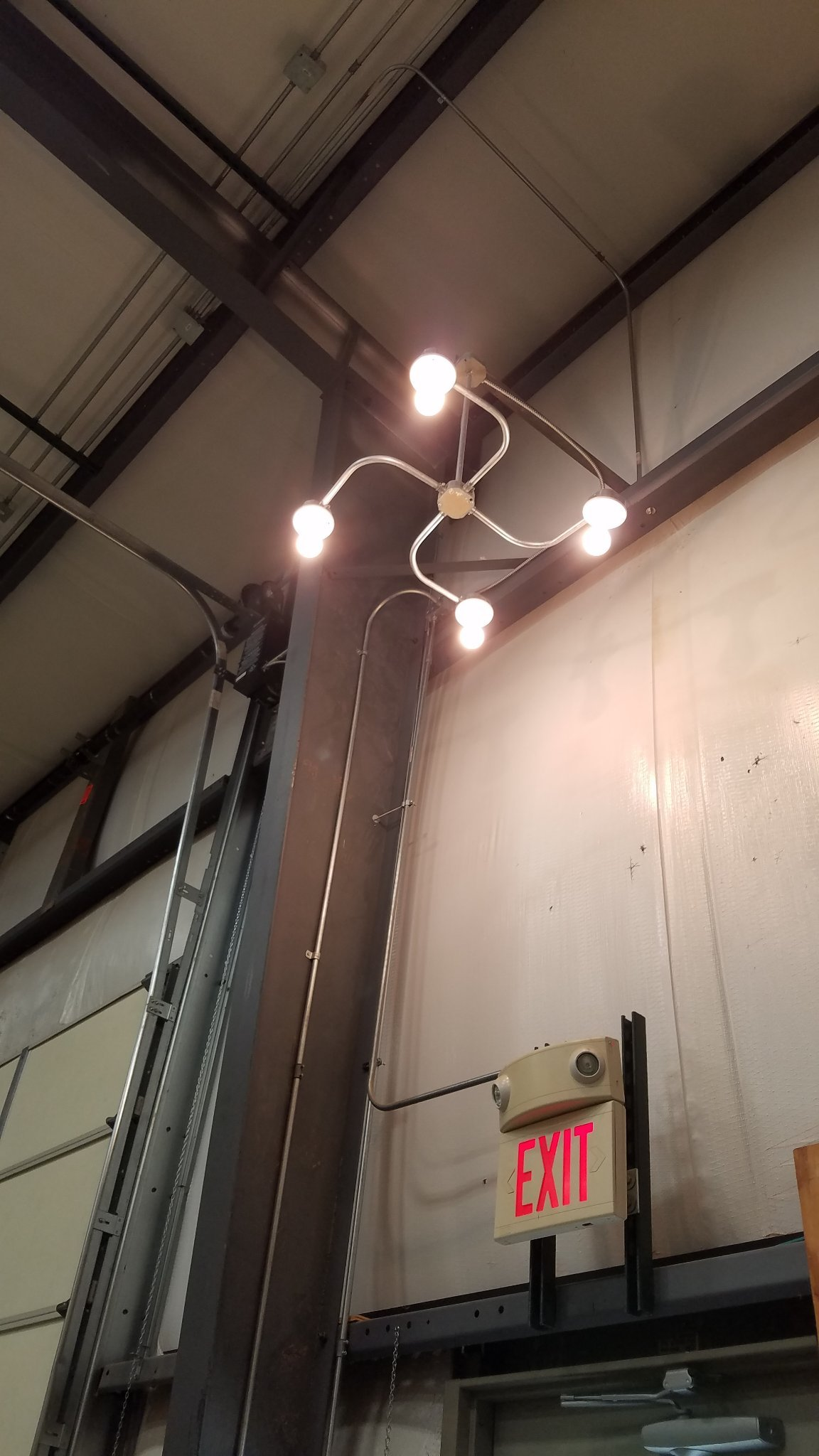 """The electrical instructor made a """"cool swirly light fixture"""" from conduit - meme"""