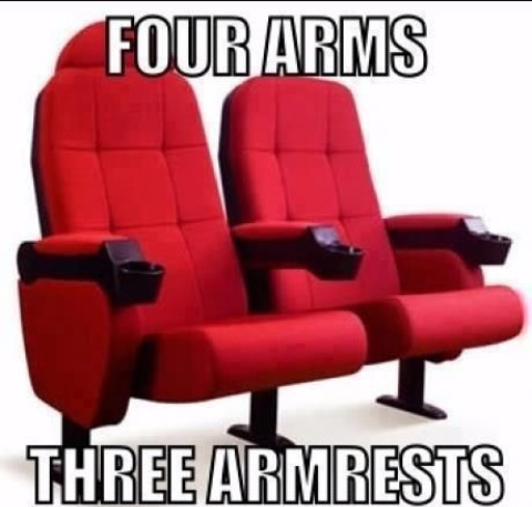 Middle armrest is not claimed when two strangers sit next to each other - meme