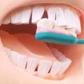 Teeth cleaning a brush